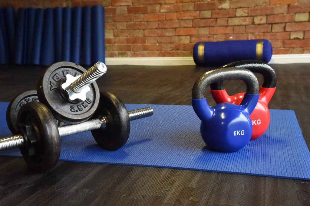 DUMBELLS AND KETTLEBELLS ON A MAT
